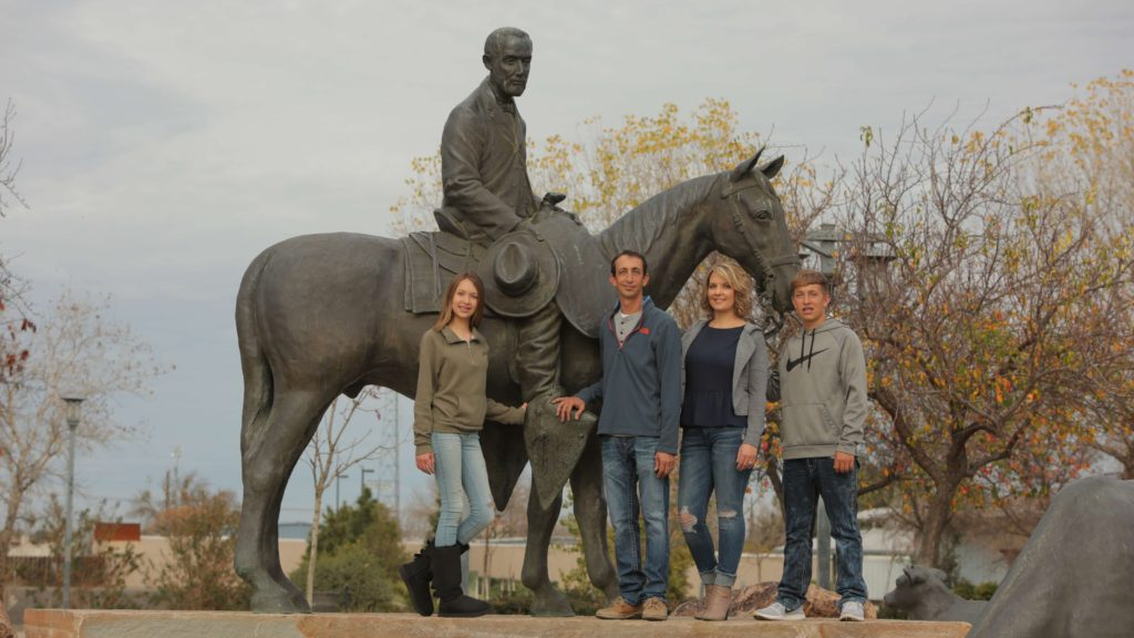 scott and family at statue