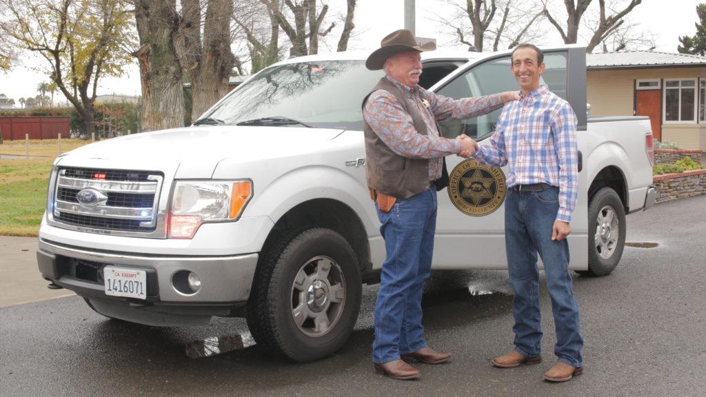 scott and sheriff handshake
